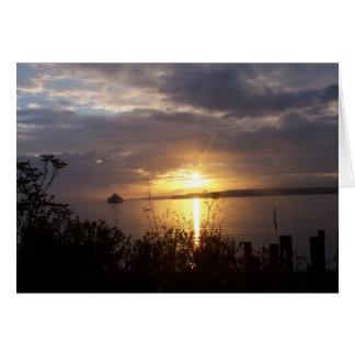 Cartão balsa no nascer do sol