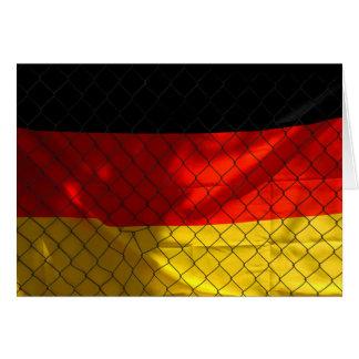 Cartão Bandeira de Alemanha atrás da cerca do elo de