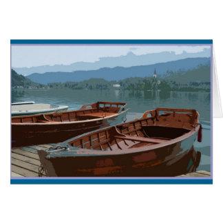 Cartão Barcos de madeira no lago sangrado, Slovenia