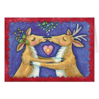 Cartão Beijando a rena sob o visco - amor em Chr