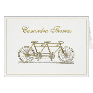 Cartão Bicicleta dourada construída para dois o quadro H