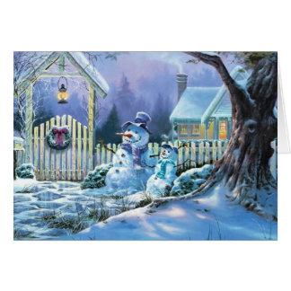 Cartão Boneco de neve do inverno na frente de uma casa de