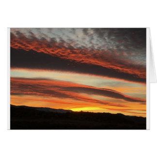 Cartão bonito do por do sol do deserto de Reno