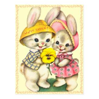Cartão bonito dos miúdos dos coelhinhos da Páscoa