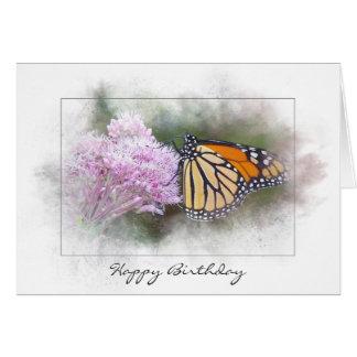 Cartão borboleta de monarca do aniversário no wildflower