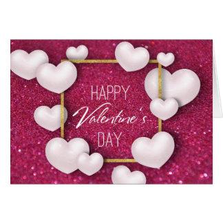 Cartão branco do brilho dos corações do dia dos