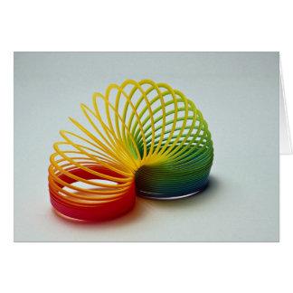 Cartão Brinquedo furtivo do arco-íris colorido para