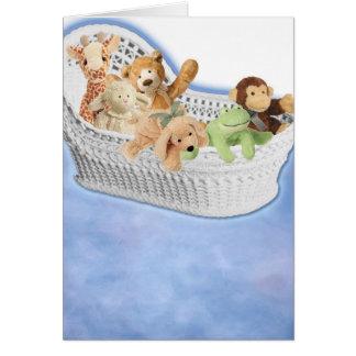 Cartão Brinquedos do luxuoso na cesta de moses