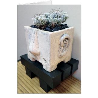 Cartão Cabeça do pote com o cacto do dedal pela planta