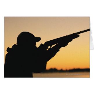 Cartão Caçador e arma