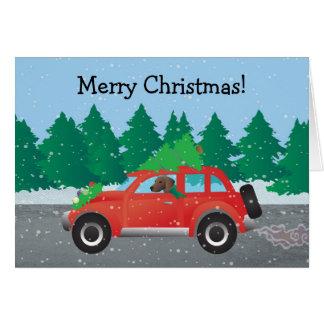 Cartão Cão de cão de Plott que conduz o carro do Natal