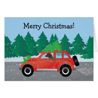 Cartão Cão de Redbone que conduz um carro do Natal
