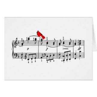 Cartão cardinal do Natal da música alegre