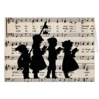 Cartão Carolers das crianças com música do Natal