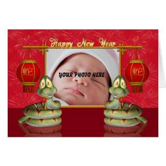 Cartão chinês do ano novo da foto - ano do cobra