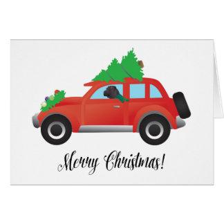 Cartão Chinês preto Shar-Pei que conduz o carro do Natal