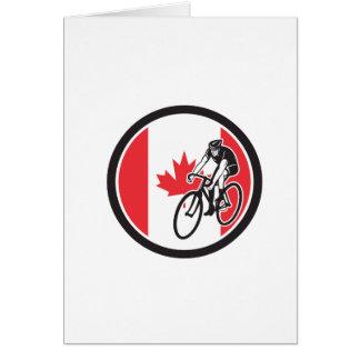 Cartão Ciclista canadense que dá um ciclo o ícone da