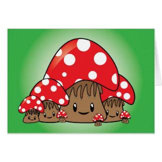 Cartão Cogumelos bonitos no fundo verde