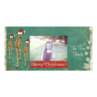 Cartão com fotos festivo do Feliz Natal dos girafa