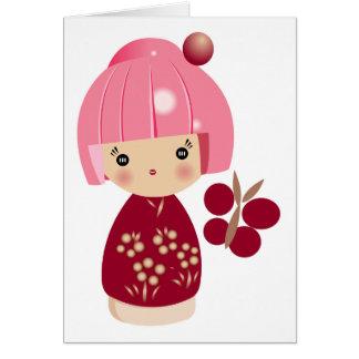 Cartão cor-de-rosa da objectiva tripla de Kokeshi