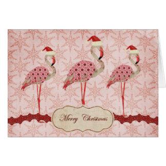 Cartão cor-de-rosa do Feliz Natal dos flamingos do