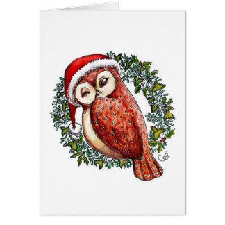 Cartão Coruja do Natal em um chapéu do papai noel