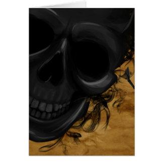 Cartão Crânio de sorriso preto cercado por bastões e por