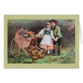 Cartão Crianças com o carro dos ovos da páscoa
