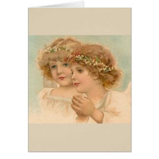 Cartão Crianças em grinaldas principais florais,