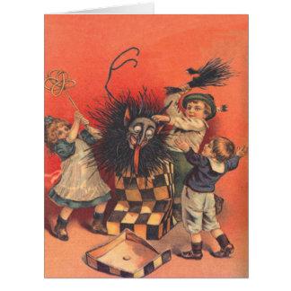 Cartão Crianças que batem o Jack-Em-UM-Box de Krampus