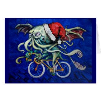 Cartão Cthulhu em uma bicicleta
