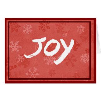 Cartão Cumprimento da alegria com fundo vermelho do floco