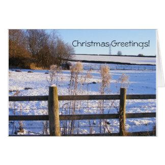 Cartão Cumprimentos nevado da paisagem do Natal!