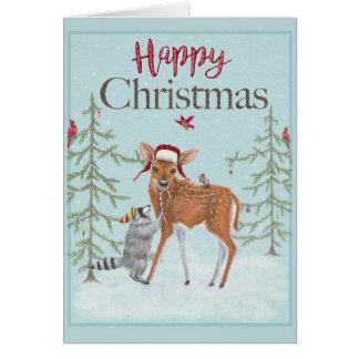 Cartão da jovem corça e do guaxinim do Natal feliz