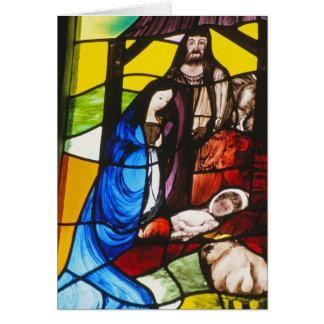 Cartão da natividade do vidro colorido
