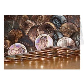 Cartão da pirâmide da moeda de um centavo