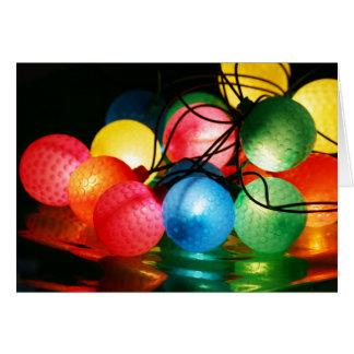 Cartão das luzes de Natal da bola de golfe