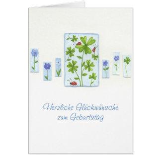 Cartão de aniversário com trevos e besouros de
