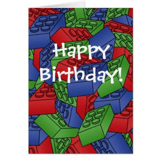 Cartão de aniversário com uma pilha dos blocos de