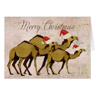Cartão de bronze festivo do Feliz Natal dos camelo