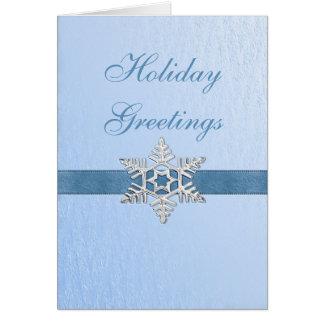 Cartão de cartões de natal azul do floco de neve