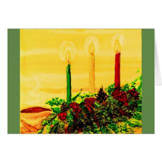 cartão de cartões de natal com registro e velas de
