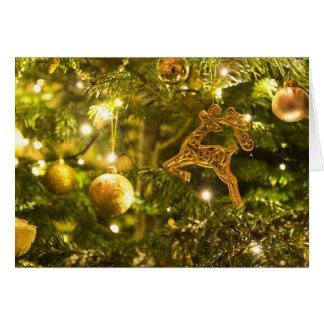 Cartão de cartões de natal dourado do Natal das