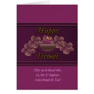 Cartão de Diwali com a lâmpada e as flores roxas