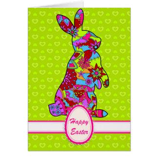 Cartão de felz pascoa com coelho no verde