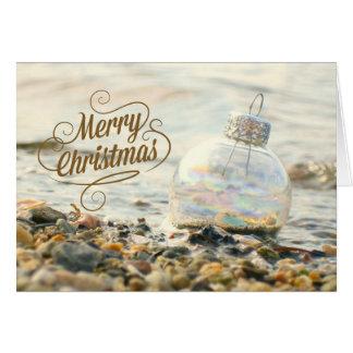 Cartão de Natal alegre da praia