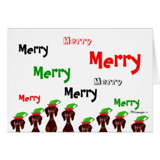 Cartão de Natal alegre de muitos Dachshunds