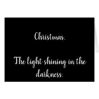 Cartão de Natal com texto em preto e branco.