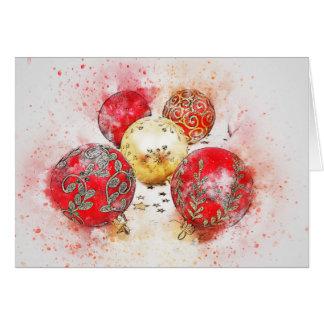 Cartão de Natal com vermelho e ornamento do ouro