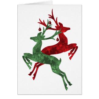 Cartão de Natal da rena do desenhista no vermelho